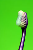 Brush your teeth. Tooth brush with paste green back ground Royalty Free Stock Photography