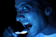 Brush Your Teeth. A funny image showing an Indian man brushing his teeth in the night Royalty Free Stock Photos