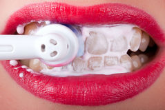 Brush your teeth V2. White teeth are brushed with an electric toothbrush Stock Images