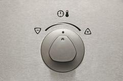 Brushed aluminium oven knob. Modern style Royalty Free Stock Photos