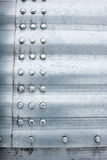 Metal background. Brushed aluminum metal plate with bolts Royalty Free Stock Photos