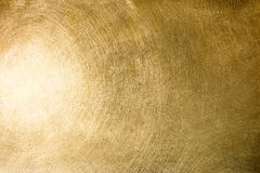 Brushed brass plate with multiple scratches and light reflection Stock Image