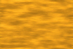 Brushed Gold Texture. Brushed gold shadowed background texture with rustic antique finish Stock Photos