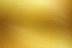 Brushed golden metal foil surface, abstract texture background.  stock photos