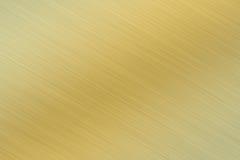 Brushed metal. A Brushed metal texture background - golden look Stock Photos