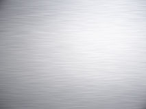 Brushed metal. A large sheet of rendered brushed steel or metal as background stock photography