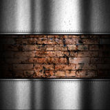 Brushed metal background with brick Stock Images