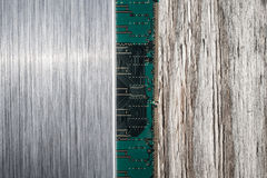 Brushed metal,computer chip and wooden background Royalty Free Stock Images
