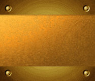 Brushed metal golden plate Stock Image