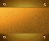 Brushed metal golden plate Stock Image
