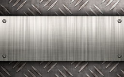 Brushed Metal Layout. Worn diamond plate metal texture with a brushed aluminum plate riveted to it.  Makes a great layout or business card template Stock Photography