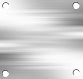 Brushed metal plate. With drilled holes Royalty Free Stock Photography