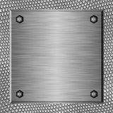 Brushed metal plate b. Shiny brushed metal plate against abstract background Royalty Free Stock Photography
