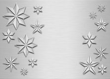 Brushed metal snowflakes Stock Images