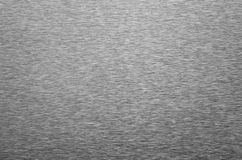 Brushed metal surface. A gray brushed metal surface stock photography