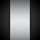 Brushed metallic panel on black mesh Royalty Free Stock Photos