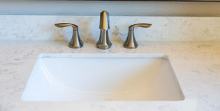 Brushed Nickel on Marble. Brushed Nickel faucets on Marble Vanity royalty free stock photo