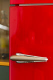 Brushed Silver Handle on Door of Red Refrigerator Royalty Free Stock Images