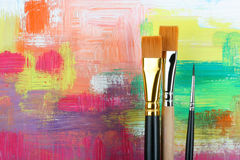 Brushes. New brushes on painted background stock image