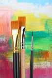 Brushes. New brushes on painted background royalty free stock photos