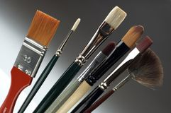Brushes. Colorful brushes on a gradient background Royalty Free Stock Photos