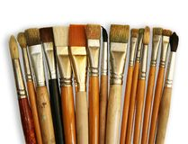 Brushes. Row of brushes isolated on white Stock Images