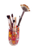 Brushes. Artists brushes in hand painted glass Stock Image