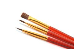 Brushes. Professional makeup brushes on a white background Stock Images