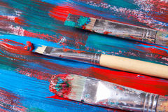 Brushes and acrylic paint background with blue and red strokes Royalty Free Stock Photography