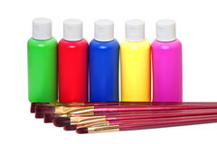 Brushes and acrylic paints Stock Photos