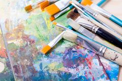 Art paint brushes. Brushes on the art palette royalty free stock photography