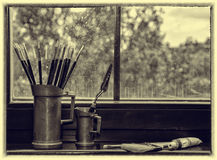 Brushes of the artist in a vase Stock Image