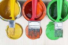 Brushes and cans with paint Stock Images