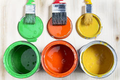 Brushes and cans with paint Royalty Free Stock Photo