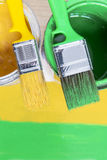 Brushes and cans with paint Royalty Free Stock Photography