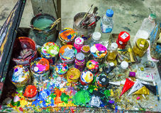 Brushes and cans of paint. On a multicolored palette Stock Photo