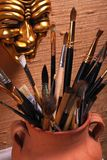 Brushes in a clay pot Royalty Free Stock Photography