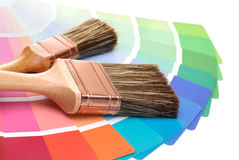 Brushes with a color guide. Two brushes on a palette color guide stock images