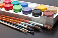 Brushes and colored paint artist Stock Image