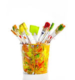 Brushes in the colorful bucket Royalty Free Stock Photo