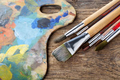 Brushes and colorful pallet Royalty Free Stock Photography