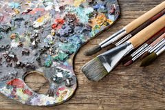 Brushes and colorful  pallet Stock Photos