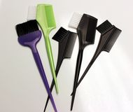 Brushes and combs. On a light background Stock Images