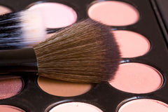 Brushes with creamy eye shadows for make up Stock Image