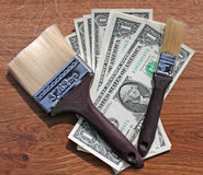 Brushes and dollars Stock Photography