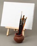 Brushes and easel stock photography