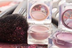 Brushes on eye shadows palette Stock Images