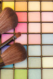 Brushes on eye shadows palette Royalty Free Stock Photo