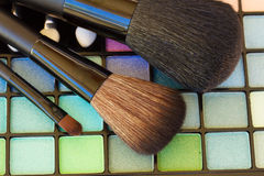 Brushes on eye shadows palette Royalty Free Stock Photography