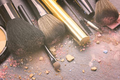 Brushes on eye shadows palette Royalty Free Stock Image